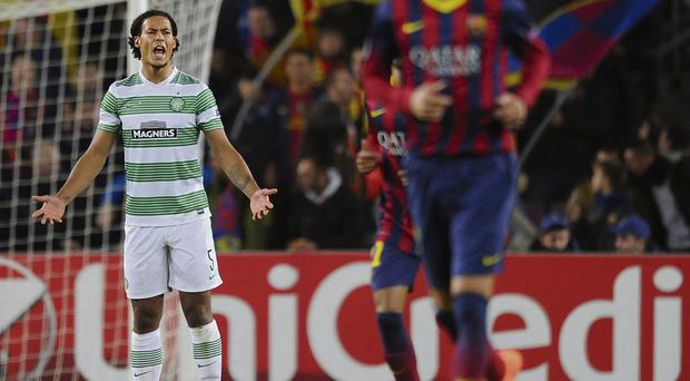 Celtic's Virgil van Dijk after Barcleona's first goal last week . . . the Scottish champions are far from being an elite European club these days