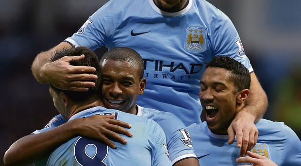 Manchester City's Luis Fernandinho celebrates scoring his side's fifth goal with team-mates in the win over Arsenal. Photo: Dave Thompson