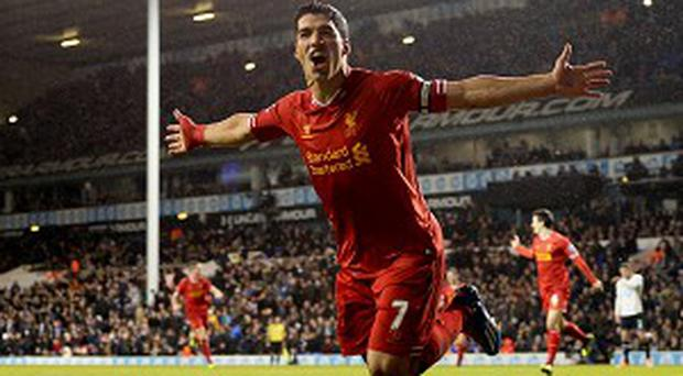 Luis Suarez celebrates his second and Liverpool's fourth in their thrashing of Tottenham