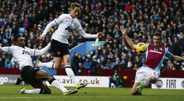 Adnan Januzaj provides the back-up as Danny Welbeck scores Manchester United's second goal despite the efforts of Ciaran Clark.