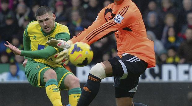 Gary Hooper lets fly to score for Norwich.