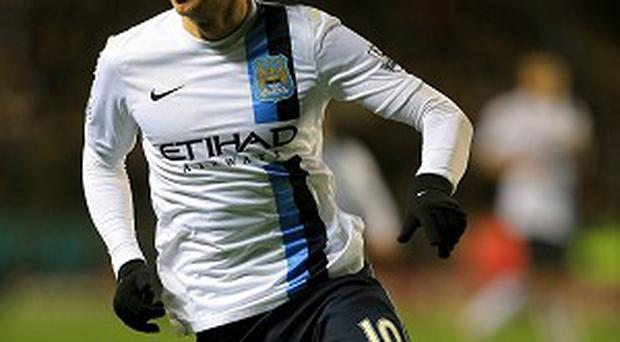 Edin Dzeko says he is the man to replace the injured Sergio Aguero up front for Man City