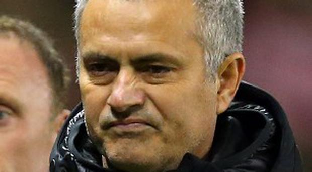 Chelsea's manager Jose Mourinho says he may reconsider his side's approach against league leaders Arsenal