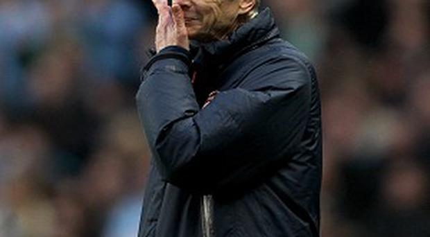 Arsene Wenger, pictured, admits Arsenal can do nothing about Jack Wilshere's ban