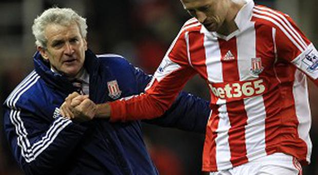 Peter Crouch, right, and Mark Hughes after the final whistle