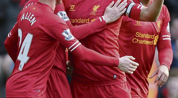 Liverpool players celebrate with Luis Suarez