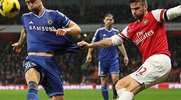 Gary Cahill, left, tries to block a cross from Olivier Giroud
