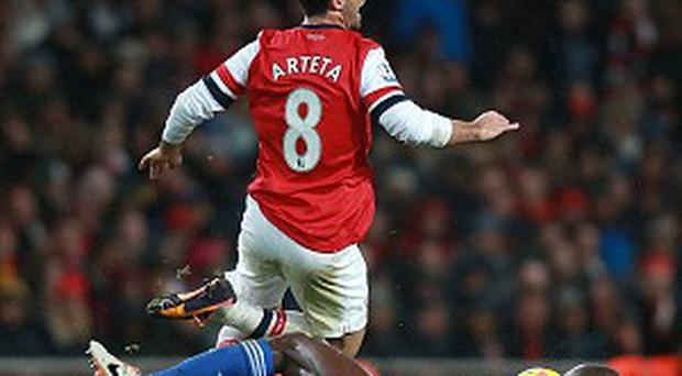 Jose Mourinho criticised Mikel Arteta, top, claiming he overreacted to a John Obi Mikel tackle