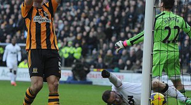James Chester holds his head after scoring an own goal