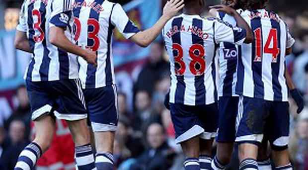 Nicolas Anelka, second right, is mobbed after scoring West Brom's second goal