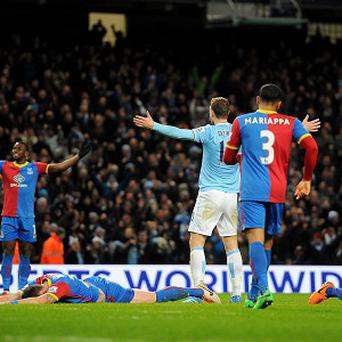 Edin Dzeko, centre, celebrates netting City's winner