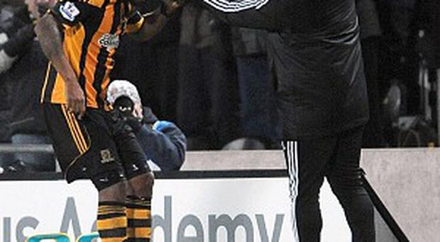 Tom Huddlestone, left, celebrates his first goal for Hull
