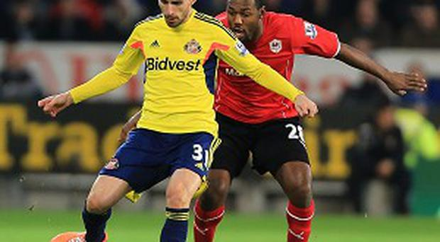 Fabio Borini, left, was taken ill during half-time against Cardiff on Saturday