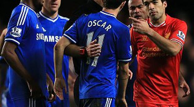 Luis Suarez, right, was criticised by Chelsea boss Jose Mourinho