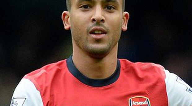 Theo Walcott says Arsenal are not getting carried away