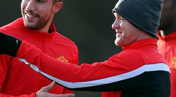 Robin Van Persie, left, and Wayne Rooney, right, are both carrying injuries