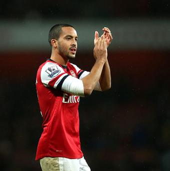 Theo Walcott believes Arsenal are getting 'stronger and stronger'