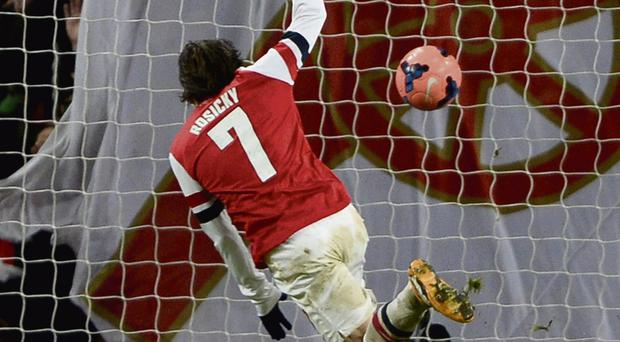 Thomas Rosicky scores Arsenal's second goal against Tottenham Hotspur in their FA Cup third round tie at the Emirates Stadium yesterday.