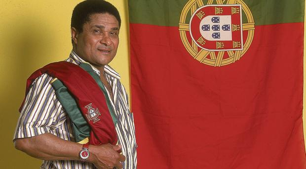Eusebio photographed in Lisbon in front of the Portuguese flag in 2000 GETTY