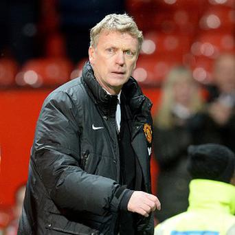 Former Scotland manager Craig Brown believes Manchester United supporters should be patient with David Moyes, pictured
