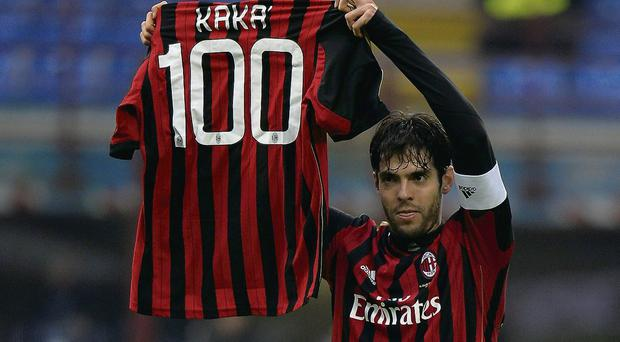 AC Milan's Kaka holds a jersey celebrating his 100th goal for AC Milan. PA WIRE