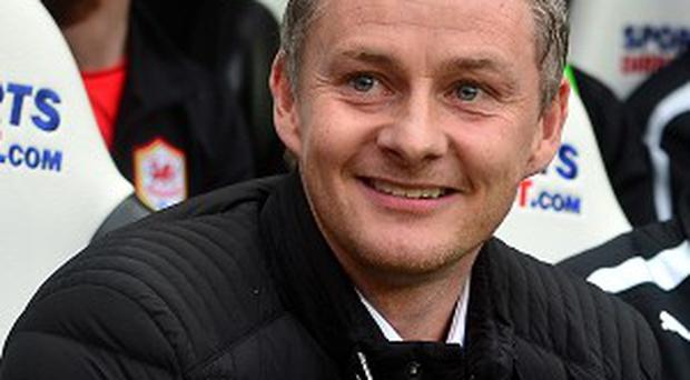 Cardiff City manager Ole Gunnar Solskjaer has made Magnus Wolff Eikrem his first signing