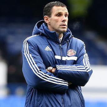 Gus Poyet, pictured, says Sunderland are close to signing Estudiantes defender Santiago Vergini