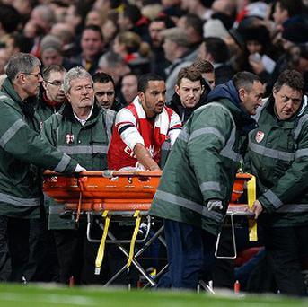 Arsene Wenger has been impressed by how Theo Walcott, pictured, has reacted to his knee injury