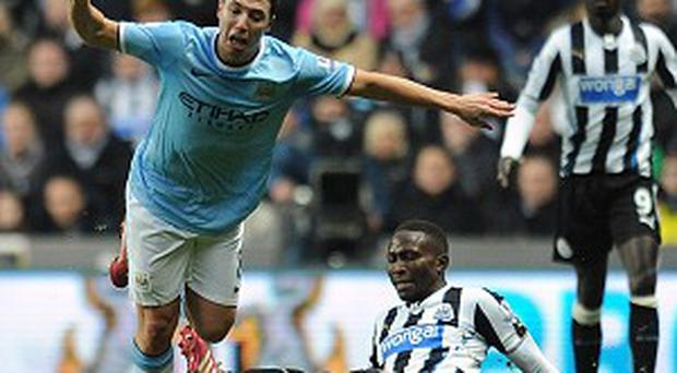 Samir Nasri, left, is set to miss eight weeks