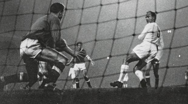 Alfredo Di Stefano backheels the ball past Harry Gregg during a 6-1 victory at Old Trafford in 1959