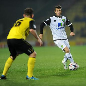 Wes Hoolahan, right, has been told he will not be leaving Norwich this month