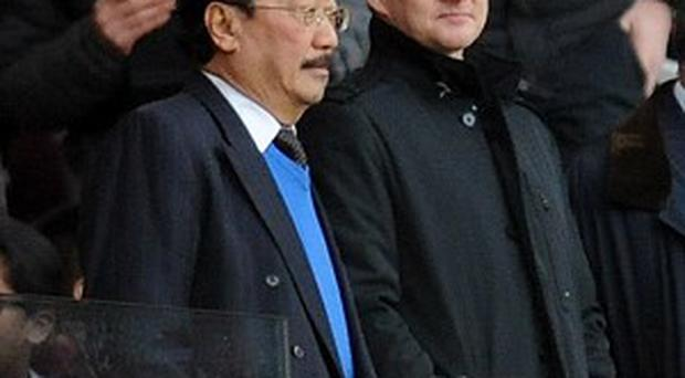 Vincent Tan, left, appointed Ole Gunnar Solskjaer, right, after sacking Malky Mackay