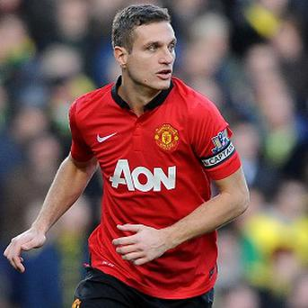Nemanja Vidic still believes Manchester United can challenge for the title