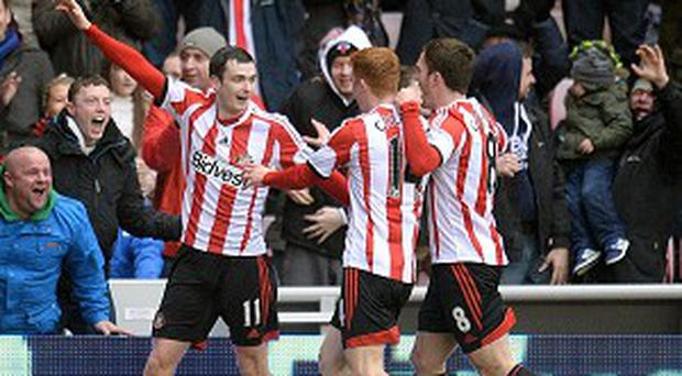 Adam Johnson, left, scored Sunderland's equaliser