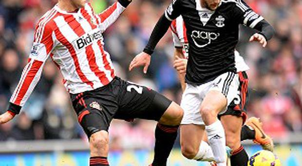 Adam Lallana, right, insists Southampton's players have not been affected by Nicola Cortese's exit