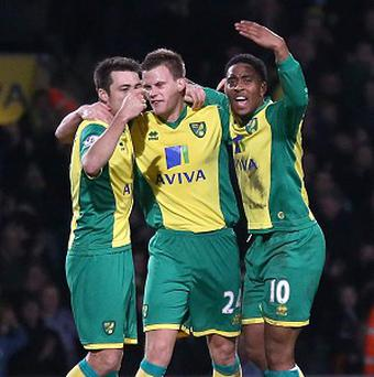 Ryan Bennett, centre, netted the winner for Norwich