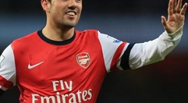 Santi Cazorla scored twice for Arsenal against Fulham