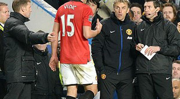 Nemanja Vidic was sent off in the dying stages of Sunday's clash at Stamford Bridge