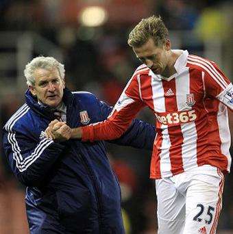 Mark Hughes, left, will not allow Peter Crouch, right, to leave