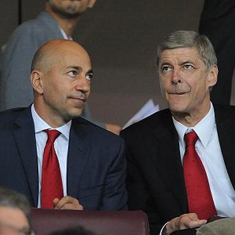 Arsenal Chief Executive Ivan Gazidis, left, is confident Arsene Wenger, right, will stay at the club, right.