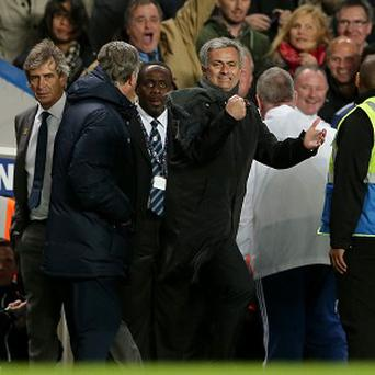 Chelsea's manager Jose Mourinho, centre, claims that he wants Manchester City to beat Tottenham