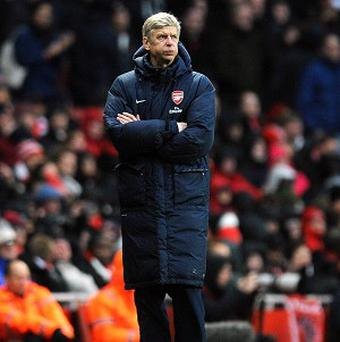 Arsene Wenger has not ruled out bringing a new player in on deadline day
