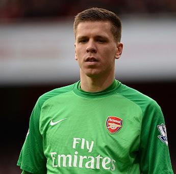 Wojciech Szczesny believes Arsenal's defence could tip the title race in their favour