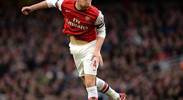 Per Mertesacker has demanded Arsenal dig deep