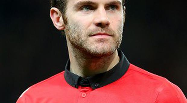 Juan Mata's arrival has given everybody a lift, according to Ryan Giggs