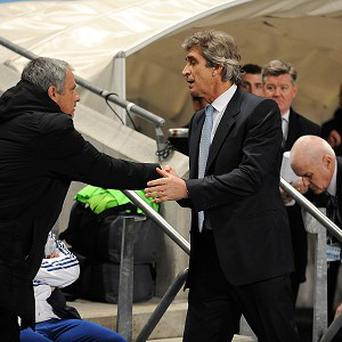 """Manchester City's manager Manuel Pellegrini, right, does not agree with Chelsea manager Jose Mourinho, left, that the Blues are a """"small horse"""""""