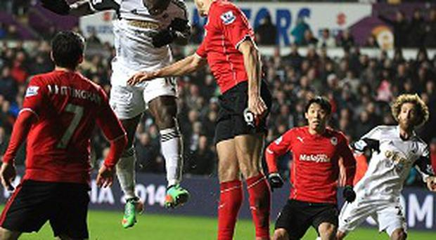 Wilfried Bony heads in the third during Swansea's emphatic victory over Cardiff