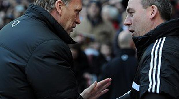 David Moyes, left, and Rene Meulensteen shake hands before the game