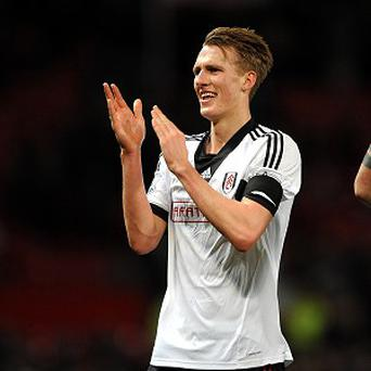 Dan Burn celebrates after Fulham snatched a 2-2 draw at Old Trafford late on