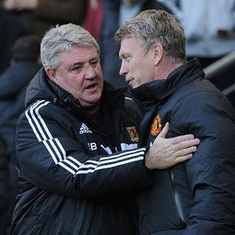 Hull City manager Steve Bruce, left, has given his support to Manchester United boss David Moyes, right.